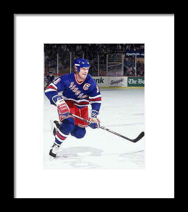 National Hockey League Framed Print featuring the photograph New York Rangers V Boston Bruins by Steve Babineau