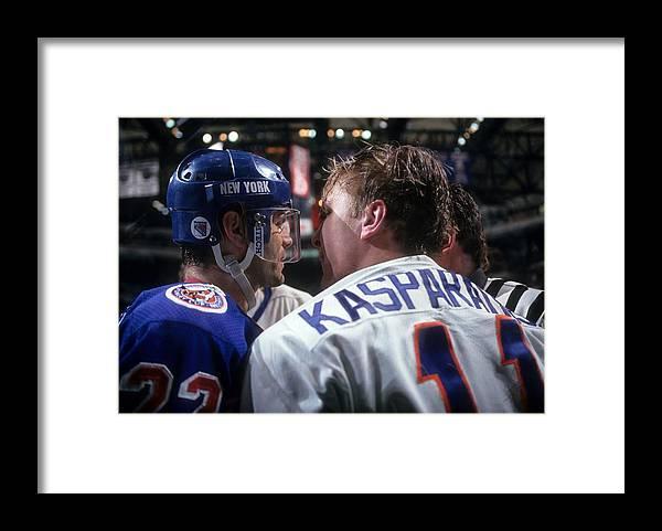 National Hockey League Framed Print featuring the photograph New York Rangers V New York Islanders by B Bennett