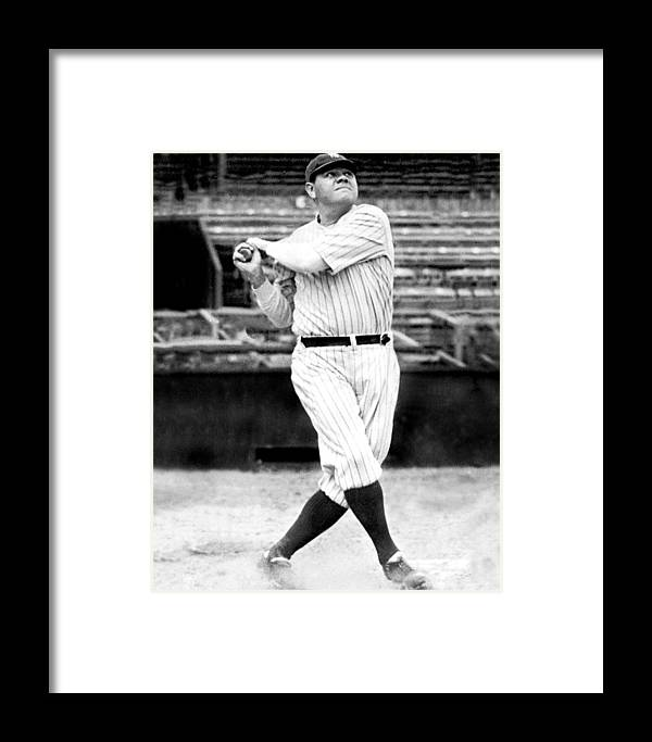 People Framed Print featuring the photograph New York Yankees Babe Ruth Swinging His by New York Daily News Archive