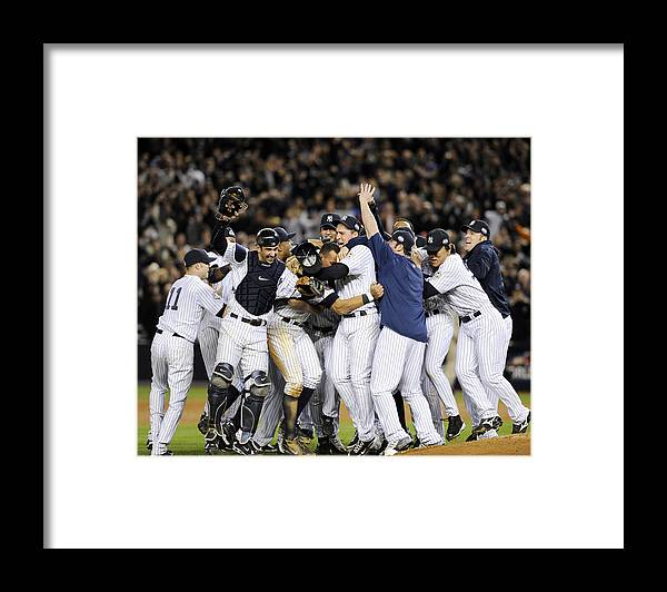 American League Baseball Framed Print featuring the photograph New York Yankees Celebrate After by New York Daily News Archive