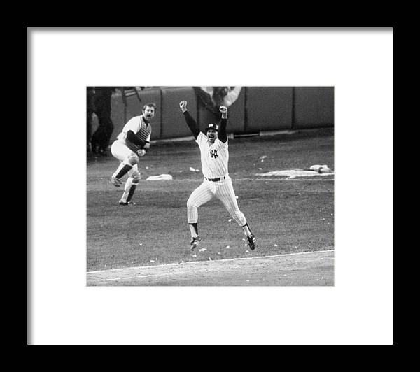 American League Baseball Framed Print featuring the photograph New York Yankees Chris Chambliss Jumps by New York Daily News Archive