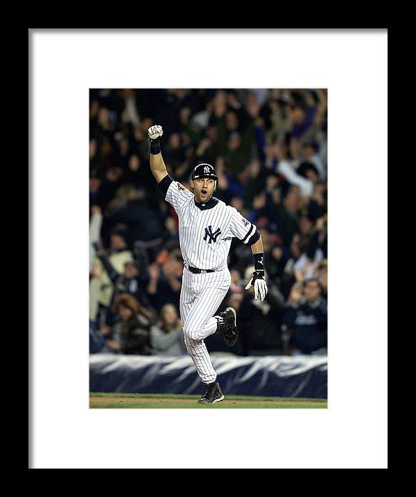 People Framed Print featuring the photograph New York Yankees Derek Jeter Celebrates by New York Daily News Archive
