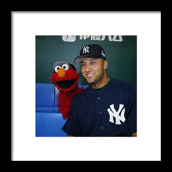People Framed Print featuring the photograph New York Yankees Derek Jeter Relaxes In by New York Daily News Archive