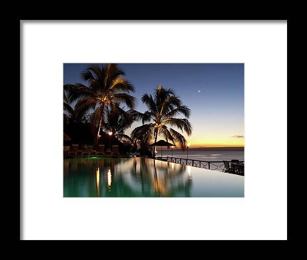 Swimming Pool Framed Print featuring the photograph Nightfall At Iririki Island, Vanuatu by Holgs