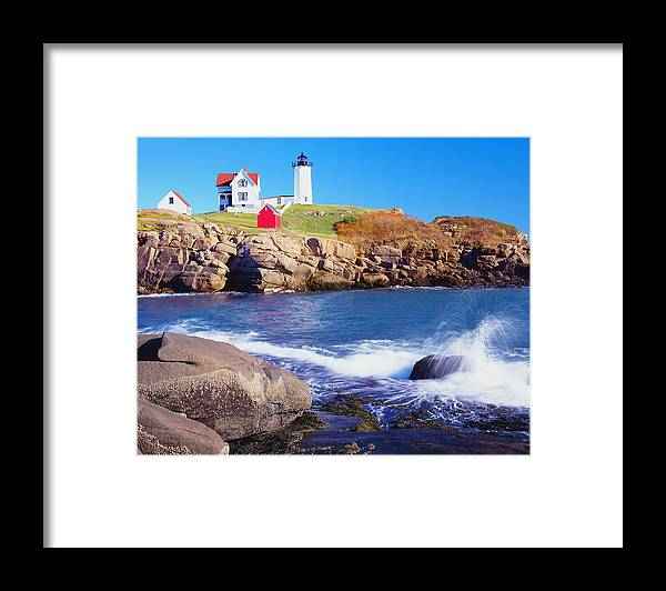 Water's Edge Framed Print featuring the photograph Nubble Lighthouse And Coastine Of Maine by Ron thomas