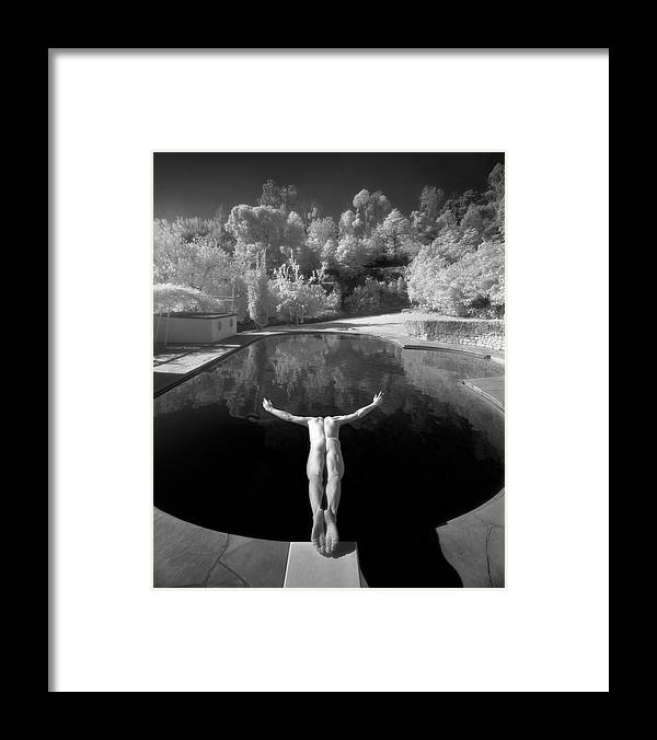 Diving Into Water Framed Print featuring the photograph Nude Male Diving Into Dark Poolicarus by Ed Freeman