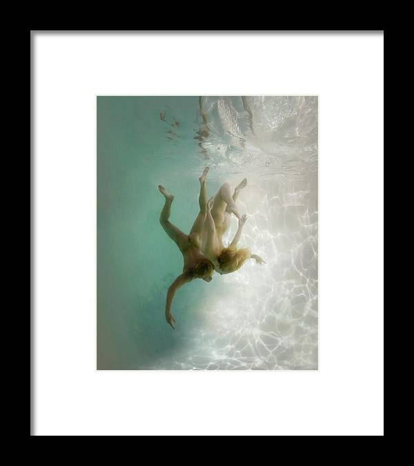 Young Men Framed Print featuring the photograph Nude Man And Woman Underwater by Ed Freeman