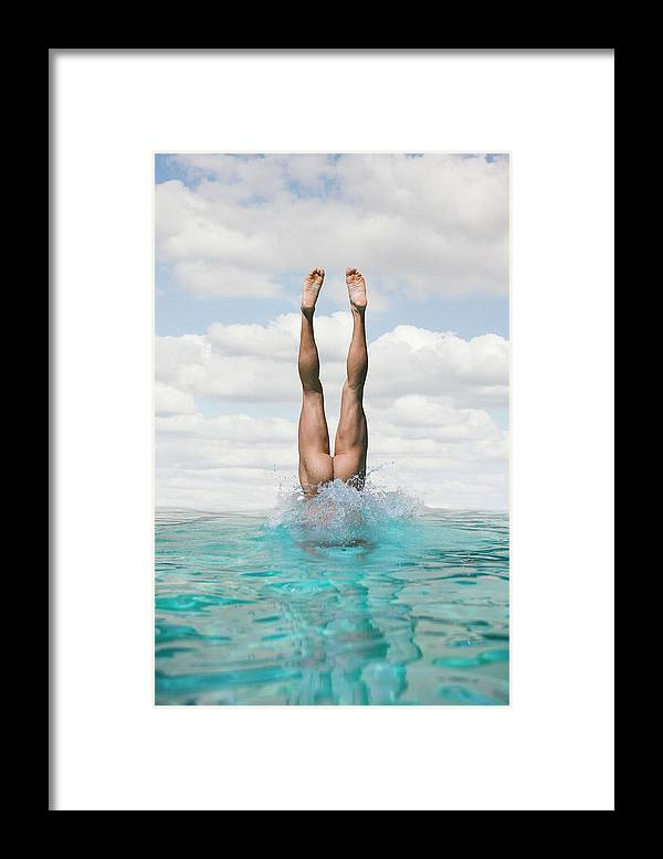 Diving Into Water Framed Print featuring the photograph Nude Man Diving by Ed Freeman