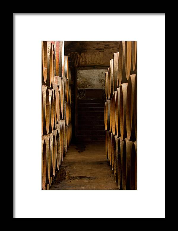 Alcohol Framed Print featuring the photograph Oak Barrels At The Wine Cellar by Kycstudio