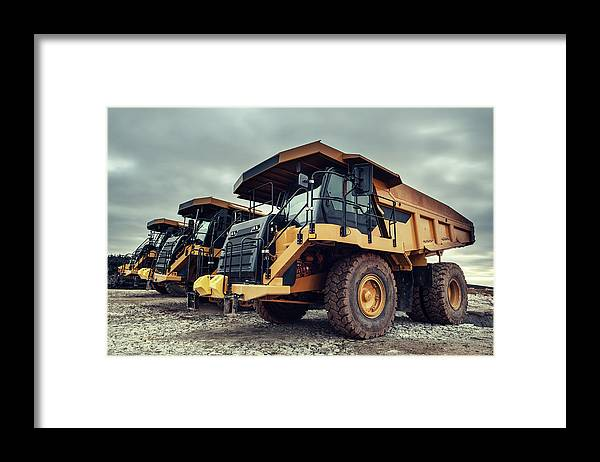 Construction Machinery Framed Print featuring the photograph Off-highway Dump Trucks by Shaunl