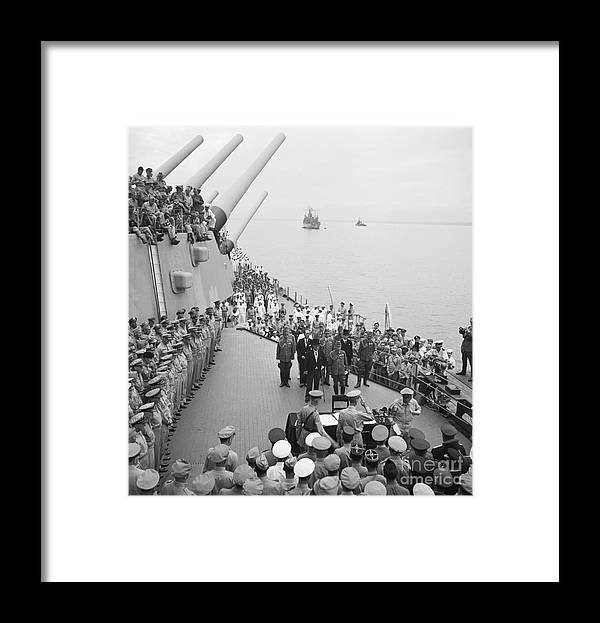 Releasing Framed Print featuring the photograph Officers Salute Macarthur As He Signs by Bettmann