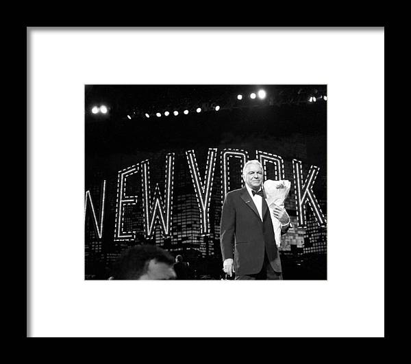 Following Framed Print featuring the photograph Ol Blue Eyes Frank Sinatra Clutches by New York Daily News Archive