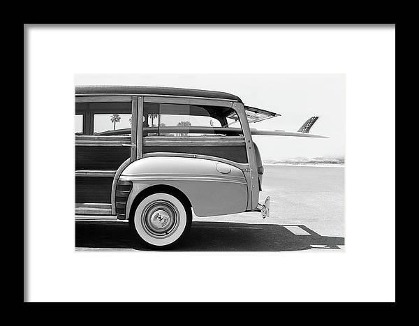 1950-1959 Framed Print featuring the photograph Old Woodie Station Wagon With Surfboard by Skodonnell