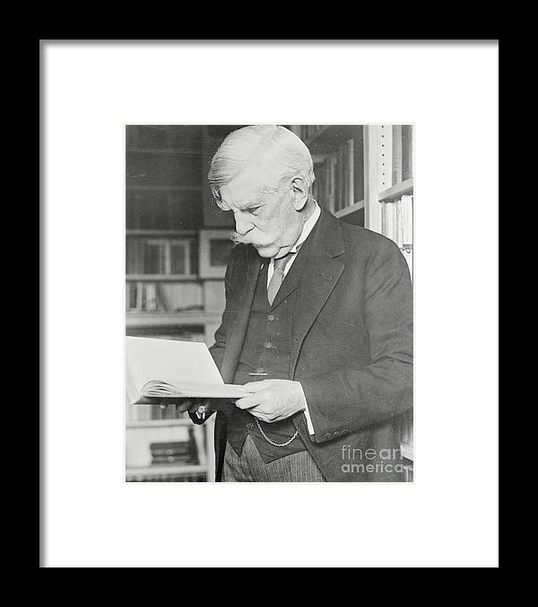 People Framed Print featuring the photograph Oliver Wendell Holmes Reading Book by Bettmann