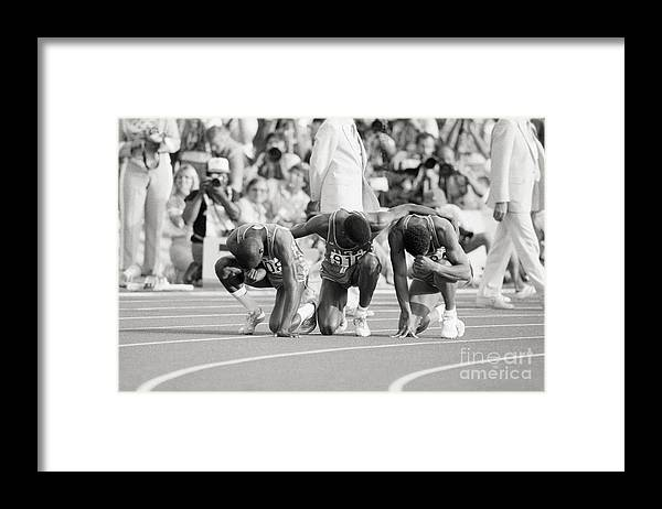 Thank You Framed Print featuring the photograph Olympic Medal Winners Pray In Thanks by Bettmann