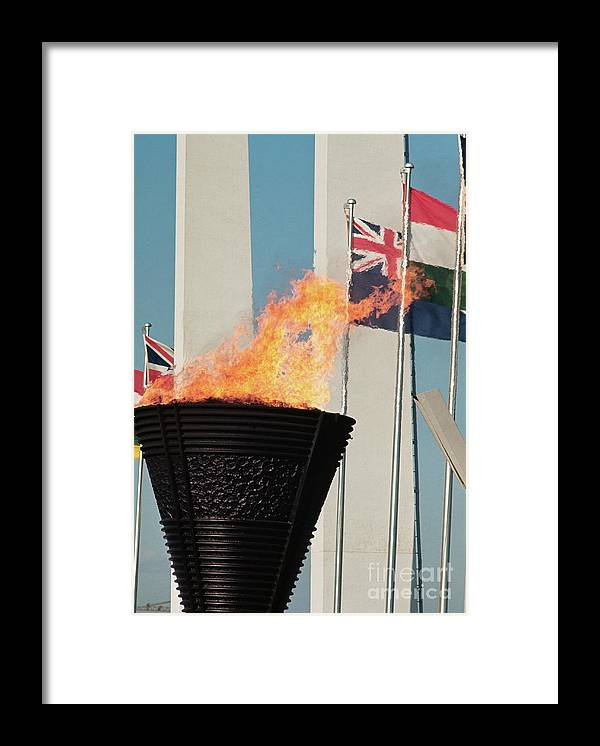 The Olympic Games Framed Print featuring the photograph Olympic Torch by Bettmann