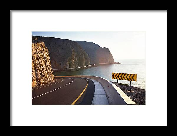 Curve Framed Print featuring the photograph Oman, Khasab, Road Round Mountain By by Christian Adams