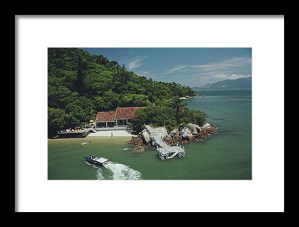 1980-1989 Framed Print featuring the photograph On The Coast Of Brazil by Slim Aarons
