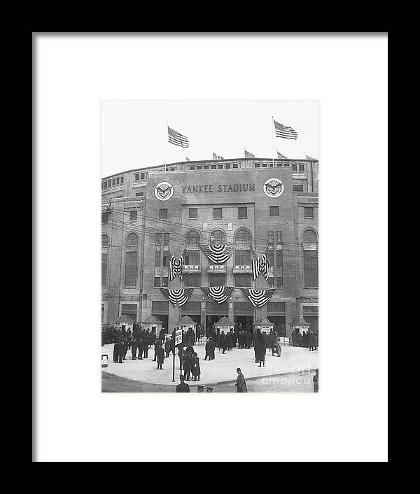 Crowd Of People Framed Print featuring the photograph Opening Day For Yankee Stadium In New by Bettmann