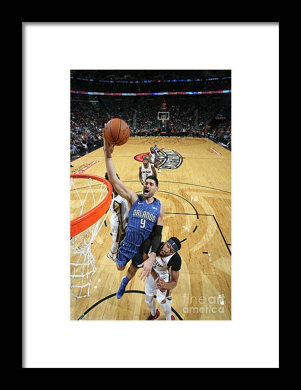 Smoothie King Center Framed Print featuring the photograph Orlando Magic V New Orleans Pelicans by Layne Murdoch