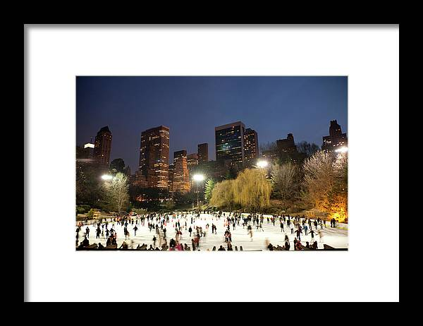 People Framed Print featuring the photograph Panorama Of People Ice Skating In by Studiokiet