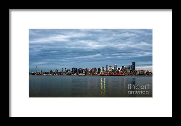 Clouds Framed Print featuring the photograph Panorama Of Seattle Skyline At Night With Storm Clouds by PorqueNo Studios