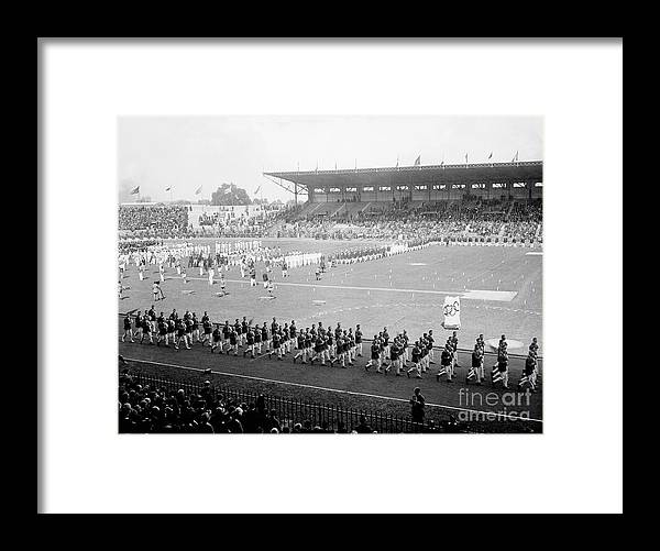 The Olympic Games Framed Print featuring the photograph Parade Opening Olympic Games by Bettmann