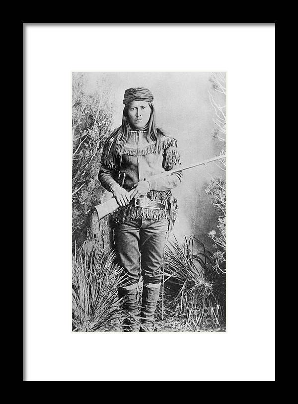 Rifle Framed Print featuring the photograph Peaches Holding Rifle by Bettmann