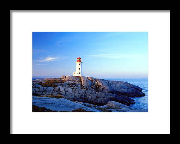 Water's Edge Framed Print featuring the photograph Peggys Cove Lighthouse At Sunrise by Photorx