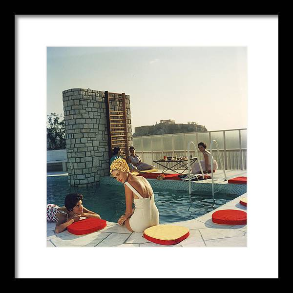 Looking Over Shoulder Framed Print featuring the photograph Penthouse Pool by Slim Aarons