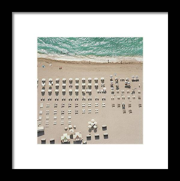 Water's Edge Framed Print featuring the photograph People At Beach, Using Rows Of Beach by John Humble