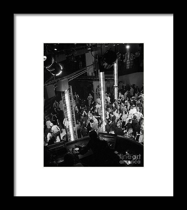 Crowd Of People Framed Print featuring the photograph People Dancing At Studio 54 by Bettmann