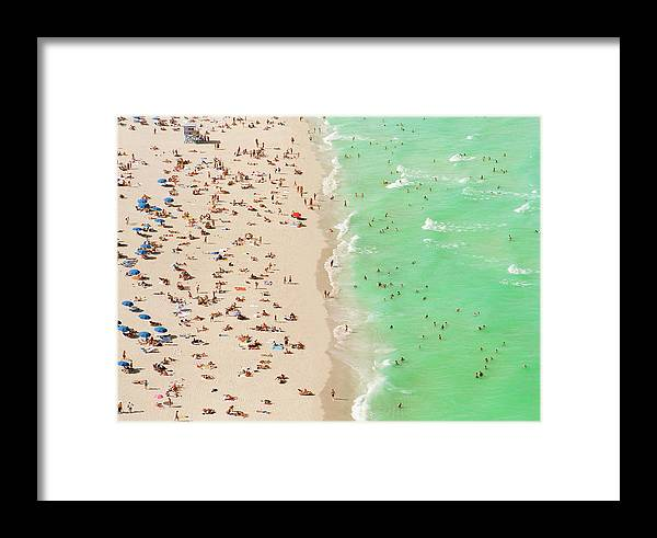 Child Framed Print featuring the photograph People On Beach An In Water, Aerial View by Matthias Clamer