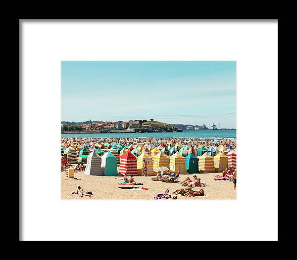 Beach Hut Framed Print featuring the photograph People Relaxing On Gijón Beach by Roc Canals Photography