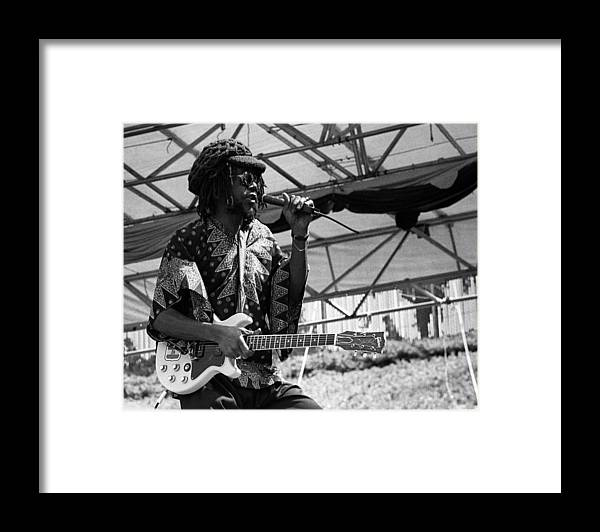 Music Framed Print featuring the photograph Peter Tosh Live by Larry Hulst