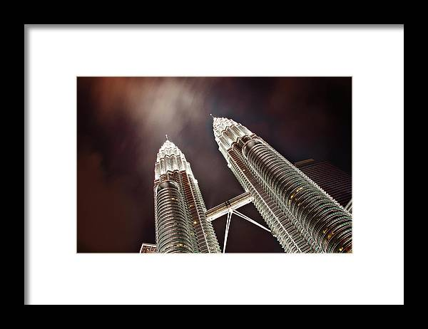 Directly Below Framed Print featuring the photograph Petronas Towers by Smerindo schultzpax