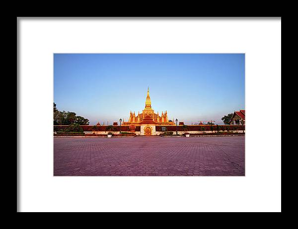 Monument Framed Print featuring the photograph Pha That Luang Stupa At Sunset by Fototrav