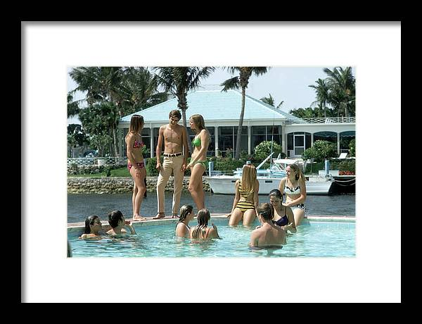 Young Men Framed Print featuring the photograph Phil Richards Pool by Slim Aarons