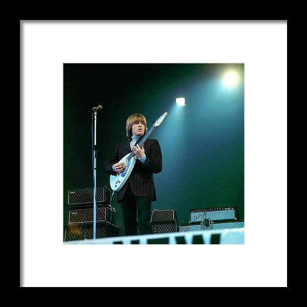 Guitarist Framed Print featuring the photograph Photo Of Vox Guitars And Brian Jones by David Redfern