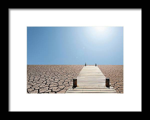 Environmental Damage Framed Print featuring the photograph Pier Over A Dry Lake Bed by John Lund