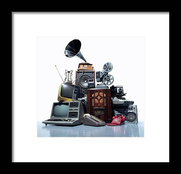 White Background Framed Print featuring the photograph Pile Of Old Technology by Pm Images