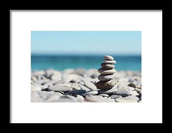 French Riviera Framed Print featuring the photograph Pile Of Stones On Beach by Dhmig Photography
