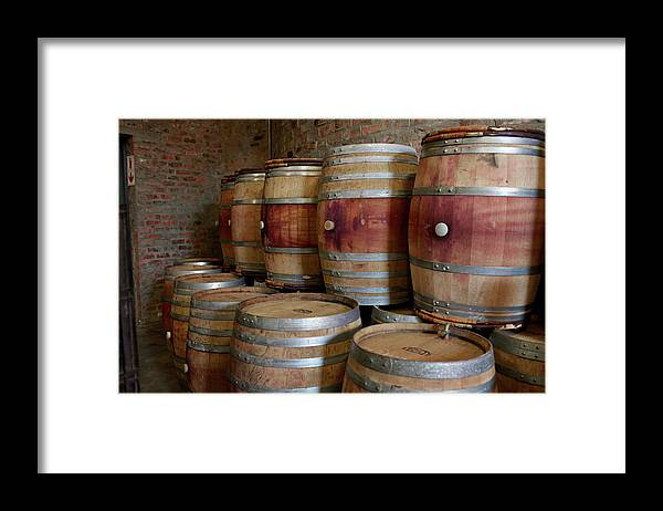 Stellenbosch Framed Print featuring the photograph Pile Of Wooden Barrels At Winery by Klaus Vedfelt