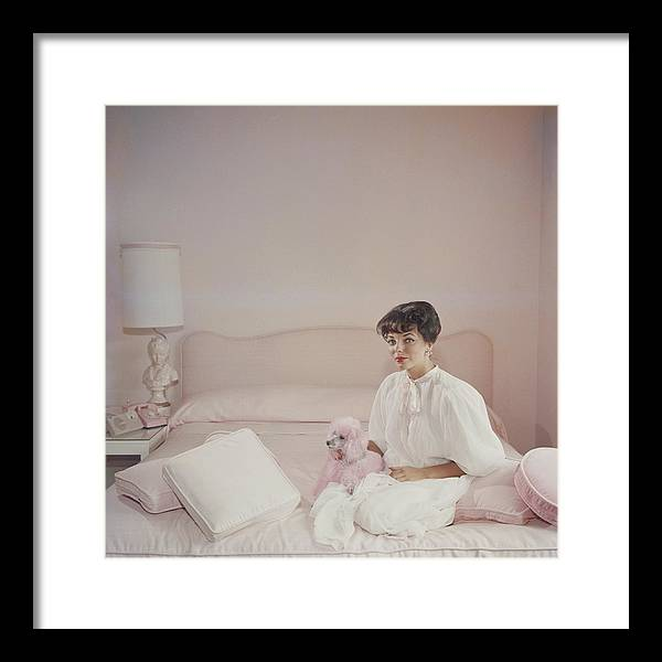 People Framed Print featuring the photograph Pink Accessory by Slim Aarons