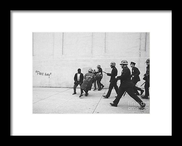 Marching Framed Print featuring the photograph Police And Students Clashing by Bettmann