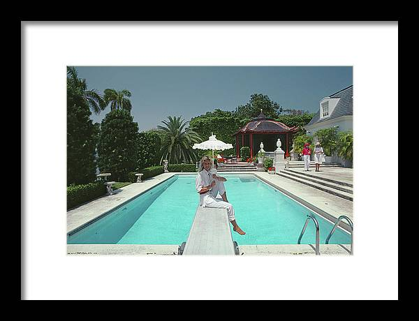1980-1989 Framed Print featuring the photograph Pool And Parasol by Slim Aarons