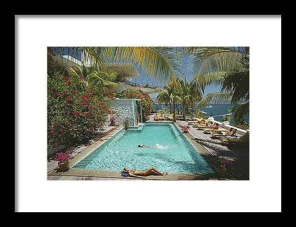 People Framed Print featuring the photograph Pool At Las Hadas by Slim Aarons
