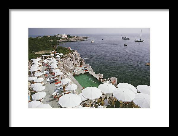 Recreational Pursuit Framed Print featuring the photograph Pool By The Sea by Slim Aarons