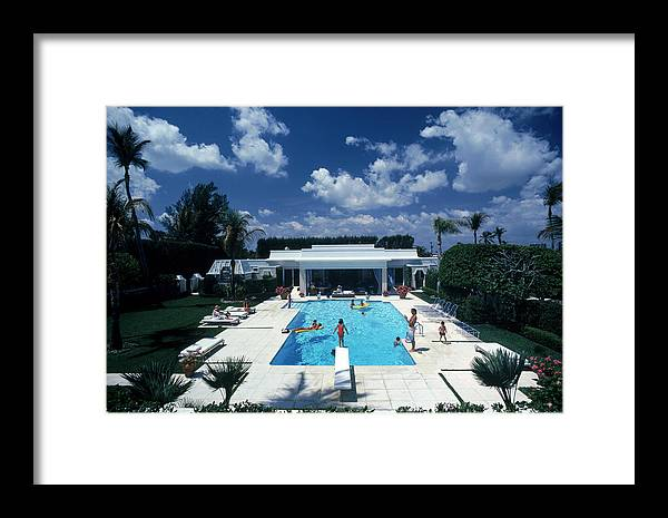 1980-1989 Framed Print featuring the photograph Pool In Palm Beach by Slim Aarons
