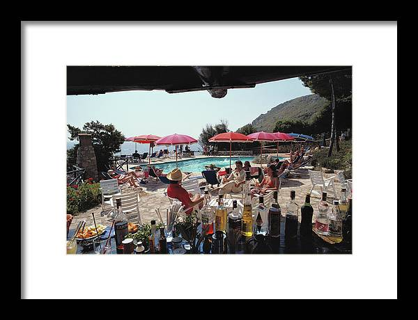 1980-1989 Framed Print featuring the photograph Poolside Bar by Slim Aarons